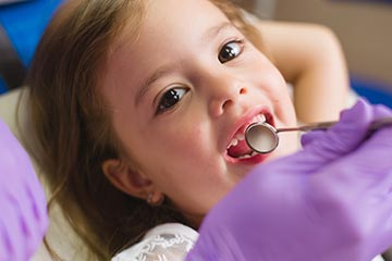 Pediatric Dentistry - Child prepares for her first dental visit