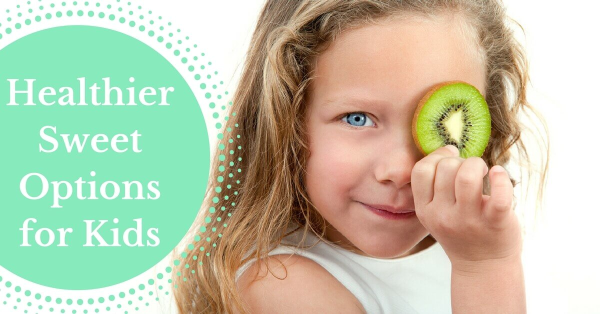 healthier sweets options for kids - young girl holds a kiwi slice over her eye