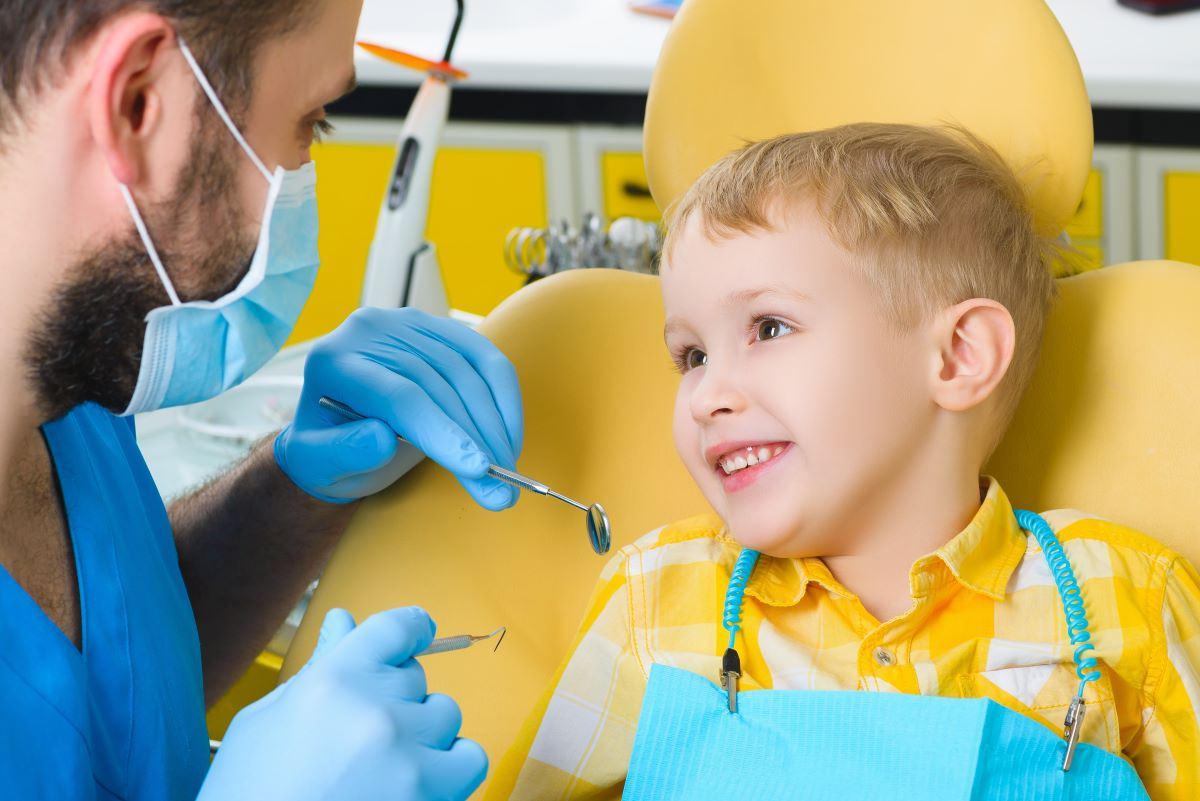 small child smiles at pediatric dentist